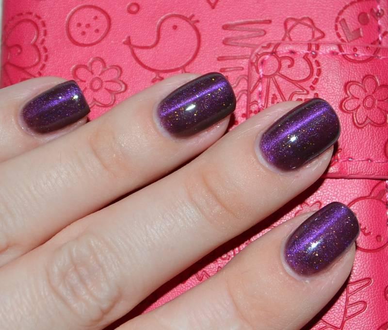 Фото кошачьего глаза на ногтях фиолетовый
